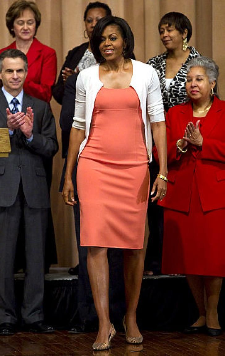 Michelle keeps it simple in a coral colored dress and white cardigan at the United States Trade Representatives Office on April 2.
