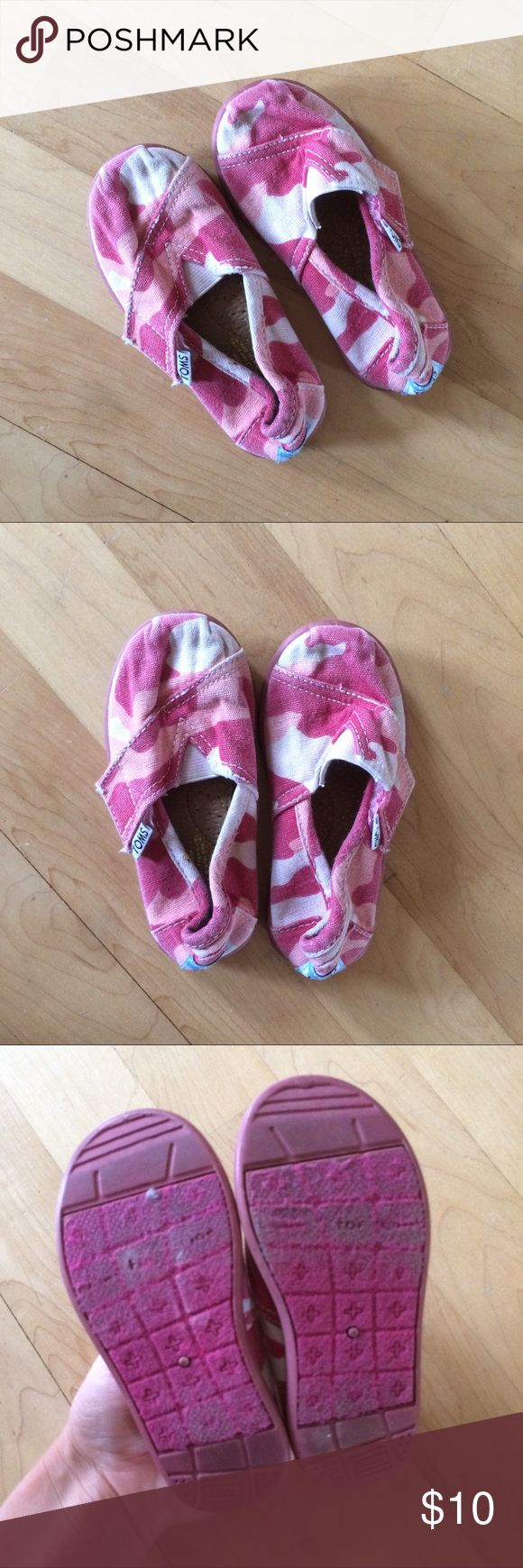 Pink camouflage Toms toddler size 6 Adorable little pink camo toms for your little girl! Sz 6 toddler. They have faded some, but otherwise GUC. They are well loved with plenty of life left. Velcro closure with elastic to allow for easy slip on. Pink light pale pink and white camo, with pink soles. Toms Shoes Sneakers