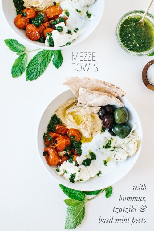 Mezze bowls packed with hummus, tzatziki, basil mint pesto, and all the fixings.