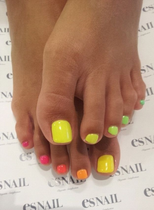Also consider this this rainbow look. | Toenail Art Is The New NailArt