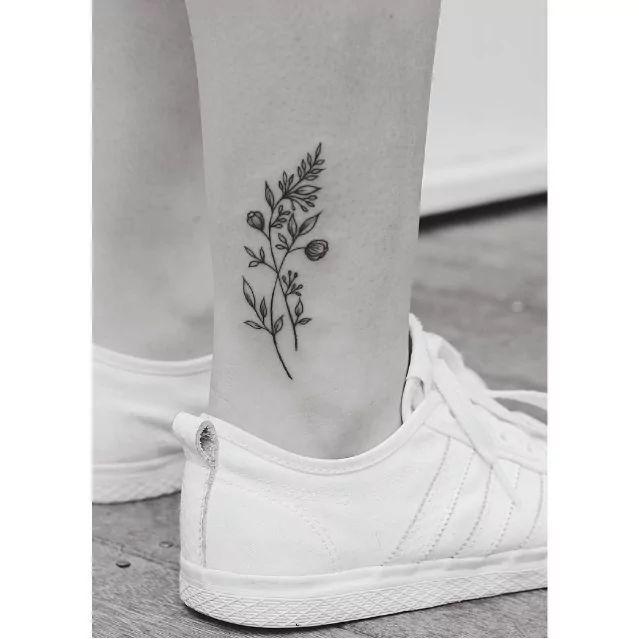 minimal floral leg tattoo by tritoan ly