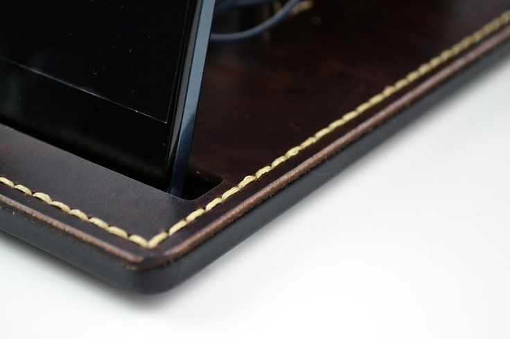 """A nice looking and usable combination of smartphone and headphones docking station.  The main construction is made from 5 mm (0.2"""") laser cut acrylic. The genuine Italian leather is put on the acrylic and then hand stitched through it.  The result is heavy duty docking station which will serve you for many years. High quality hand made item with vintage outlook.  Order it now! My site: http://dorado.pro My Etsy shop: https://www.etsy.com/shop/DoradoPro?ref=hdr_shop_menu"""