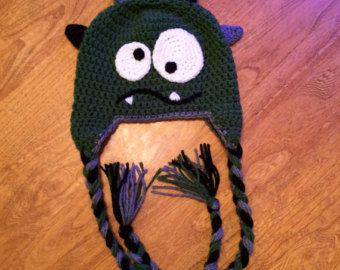 Monster Crochet Hat With Ear Flaps and Braided Ties. Monster Hat. Monster Crochet. Ear Flap Hat. Braided Ties. Monster