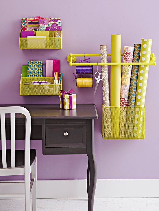 There's no one-size-fits-all DIY organization product that can take care of everything you need. But clever reinterpretation of items can help you clear out clutter in your home. Here, office desk bins and a bathroom towel bar are painted matching colors then hung on the wall to keep track of file folders, notebooks, pens, and wrapping supplies (note the clever use of a bin/towel bar to keep wrapping paper rolls upright).