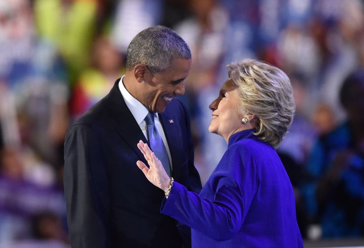 US President Barack Obama (L) speaks with US Presidential nominee Hillary…