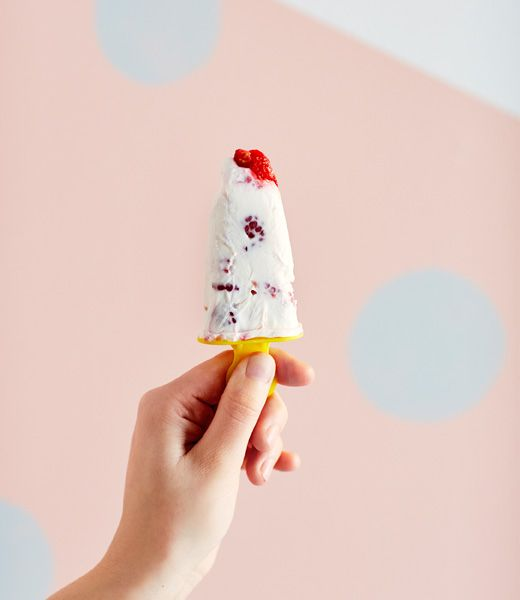 Froyo pops - so easy and nice for the summer. For this vanilla-berry version, just mix greek yogurt, vanilla, whipped cream, and raspberries together, pour into pop molds, and done.