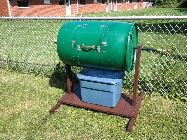 Painted wood for longevity and nice looking too.  Our homemade compost tumbler.