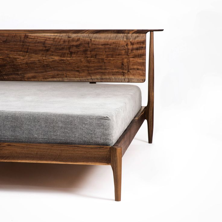This bed is made from all solid hardwoods using traditional joinery. once the mattress is on the bed the headboard has a floating look, covering the three supports from the headboard to the bed frame that give incredible strength and rigidity. All joints are hand sculpted to blend together. Storage option is available done in the same fashion as my other beds. Pictured here is Figured Walnut. Also available in any domestic hardwood including Walnut, Maple, White Oak, and Cherry. 42 high x 87…