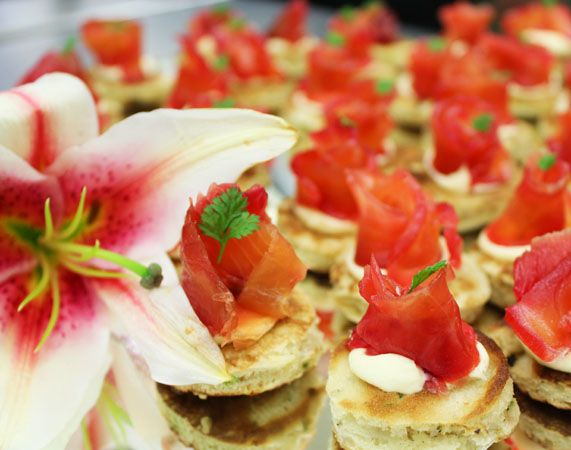Beetroot and vodka cured salmon, herb blini, creme fraiche