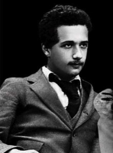 Albert Einstein young - this is a great photo - I've read that he was quite the handsome man in his day and this proves it... couldn't match his socks though... ;)