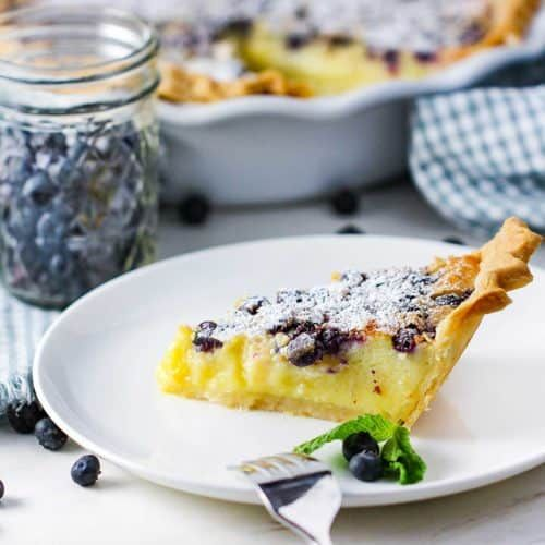 A Slice Of Blueberry Buttermilk Pie On A White Plate Buttermilk Pie Blueberry Custard Desserts