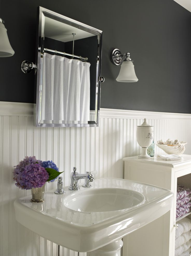 Picture Gallery Website source Bella Mancini Design Beautiful beachy cottage bathroom design with black walls paint color beadboard rectangular pivot mirror glossy white