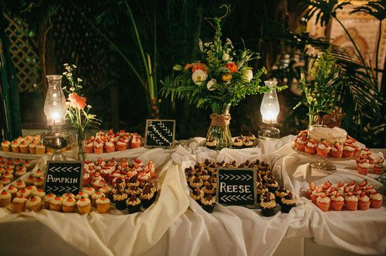 Backyard: This outdoor dessert table is simple and casual but has a variety of seasonal flavors like pumpkin cupcakes to make it unique.  Photo by Kat Braman via Green Wedding Shoes
