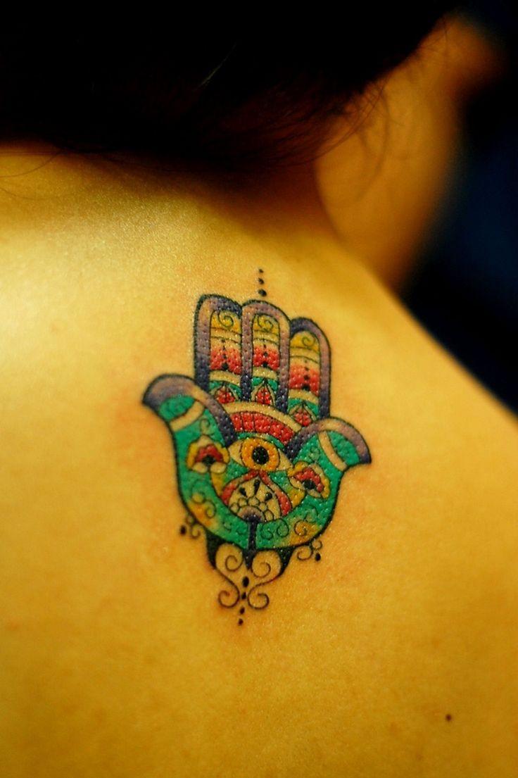 little coloured evil eye hand tattoo on the back