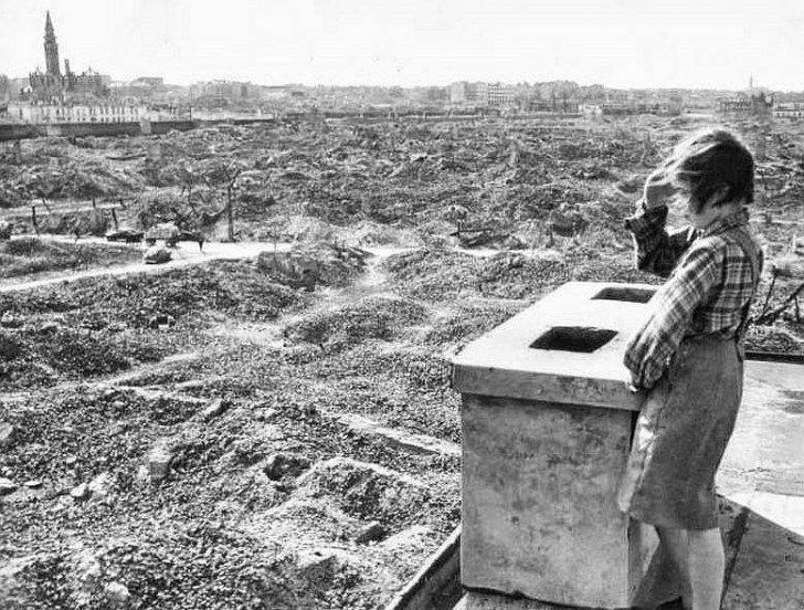 "Girl looks out over the ruins of Warsaw, Poland in 1945.  Warsaw was the most destroyed city in WWII. Manila was second. Berlin, Tokyo, or Hiroshima did not experience the same level of destruction as Warsaw. Over 80% of the city was destroyed. Hitler and Himmler ordered systematic destruction of Warsaw. Every building was razed to the ground. The level of destruction was entirely intentional. Himmler stated the city ""must be wiped from the Earth."""