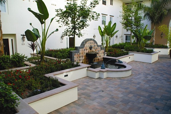 smooth stucco wall with capstone Landscape Design