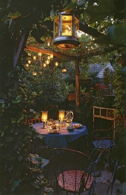 Outdoor lighting sets the mood for an intimate evening in this cozy garden space.