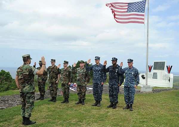 Sailors from Naval Air Facility Atsugi recite the oath of enlistment during a re-enlistment ceremony on Mount Suribachi. Iwo To, formally known as Iwo Jima, was the site of a major World War II battle with more than 26,000 American casualties and nearly 22,000 Japanese fatalities. The monument marks the spot where the iconic photograph of the Marines raising the flag was taken on Mount Suribachi.
