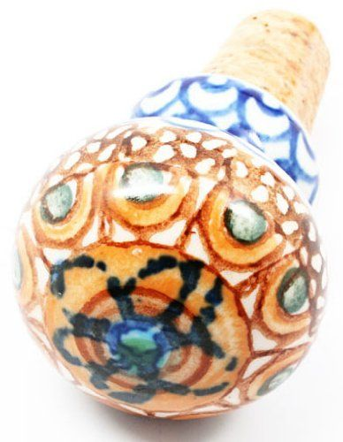 Polish Pottery Unikat Wine Bottle Stopper by Cermika Artystczna. $18.00. Quality 1 Guaranteed from the Renowned Ceramika Artystyczna. Crack and Chip Resistant. Polish Pottery is Oven, Microwave, and Dishwasher Safe!. Hand Painted and Signed by the Artist Maryla Iwicka. Signature Unikat Design. *  Lead and Cadmium Free--Safe for Everyday Use