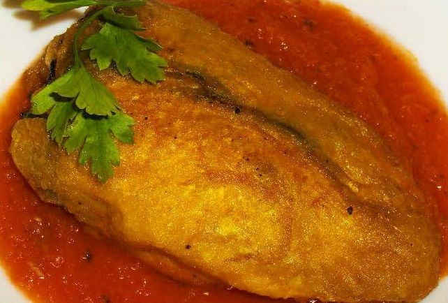 Chili Rellenos. Authentic home-made sauce and chilies stuffed with real Mexican cheese! You won't find Chili Rellenos like these anywhere! Serves 6.