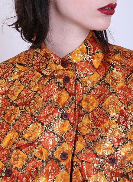 Blouse: http://retrock.com/collections/womens-blouses/products/orange-shirt
