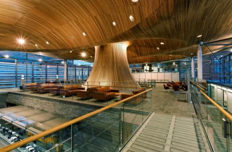 The wood-panelled funnel leading to the debating chamber dominates the public events area on the mezzanine level. Photo by Redshift Photography, National Assembly for Wales | Case studies | CABE