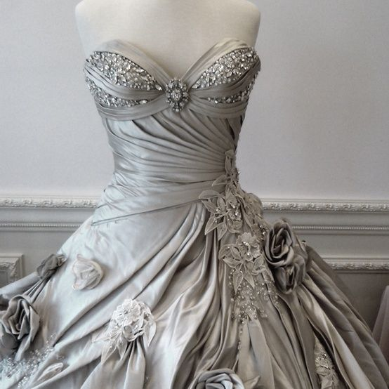 I went upstairs to dress for dinner, still bemused by what I had just observed, and found an airy, gauzy bit of lace and silver ribbons draped across the bed and gleaming in its own pale light.