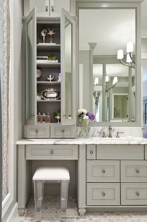 Sophisticated bathroom features gray vanity cabinets paired with a statuary marble countertop.
