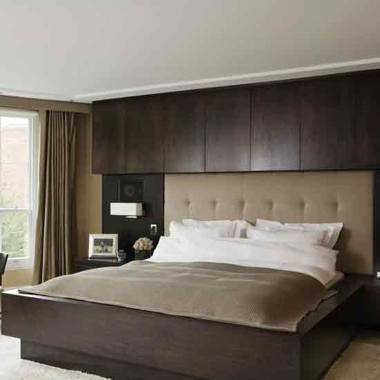 Dark Wood Panelling Behind The Bed Makes The Bed The Focal Point In This  Bedroom And Adds A Touch Of Hotel Style. The Golden Headboard Is Teamed  With ...