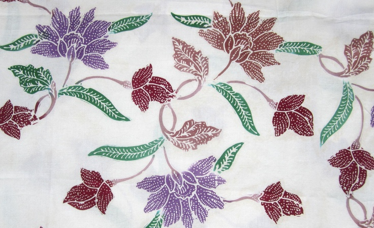 Floral block print Indonesian #batik. Soft pink background with maroon and lavender flowers.