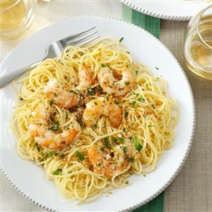 Shrimp Scampi Recipe -Shrimp Scampi looks like you fussed, but it's a snap to prepare. Lemon and herbs enhance the shrimp, and bread crumbs add a pleasing crunch. Served over pasta, this main dish is pretty enough for company. —Lori Packer, Omaha, Nebraska