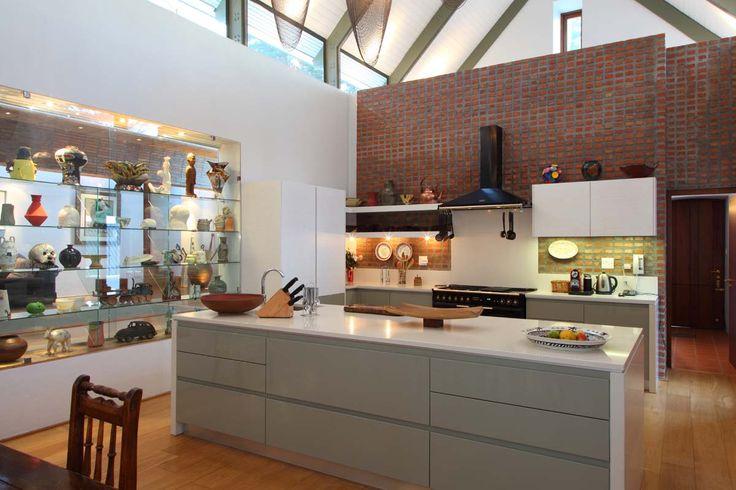 Brick wall, wooden floors, caesar stone tops, open plan, double volume kitchen.