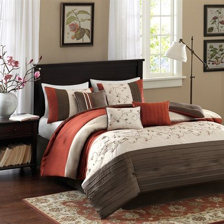 The Serene bedding collection provides an elegant look to your home. The top of the comforter is a mix of rich rust, chocolate brown, and ivory with piecing details while the ivory section has an embroidered floral pattern for a soft divide from these bold colors. Made from polyester dupioni, this fabric will produce a shine and pick up the light on both the comforter and shams. The decorative pillows come in a combination of solids, stripes, and embroidery to pull this whole set together.