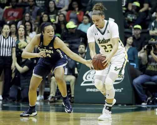 Connecticut guard/forward Napheesa Collier (24) tries to steal the ball from South Florida forward Tamara Henshaw (23) during the first half of an NCAA women's college basketball game, Monday, Feb. 27, 2017, in Tampa, Fla. (AP Photo/Chris O'Meara)