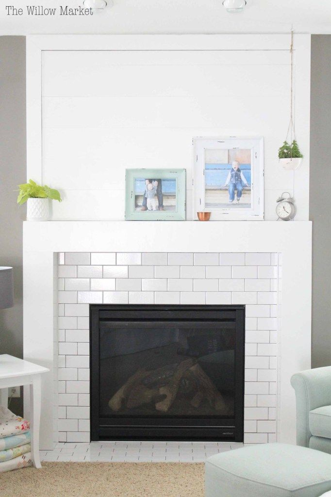 A New Fireplace With Shiplap And White Subway Tile