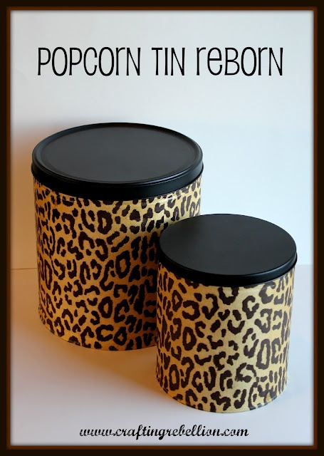 Old Popcorn Tins Reborn-I've done this and love to use mine as a cute craft supplies storage container :)