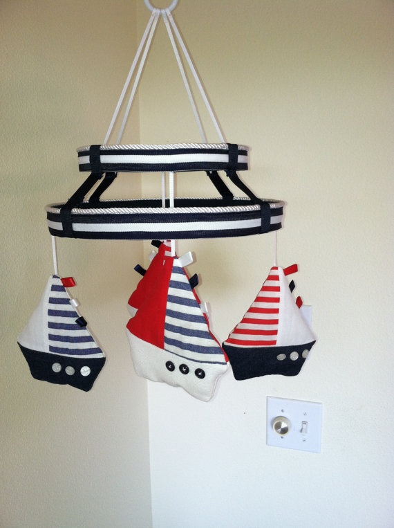 Or maybe DIY this boat mobile in the right colors with wide boat bottoms... SO CUTE!