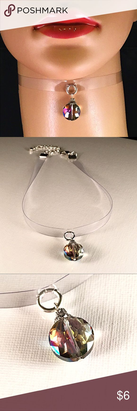 ▫️💎 Vinyl ➕ Australian glass Crystal, Choker💎▫️ ▫️💎 Vinyl ➕ Australian glass Crystal, Choker💎▫️ thin Clear Vinyl band adorned with an 🔮Australian Facetted Glass Crystal pendant that adds Beautiful Color and Sparkle 🔮12 inches ➕2 inch extender chain ➕ polished silver lobster clasp. 🖤🖤made By Mwah💋🖤🖤 got q's I'm here 😊 Mwah💋 Jewelry Necklaces