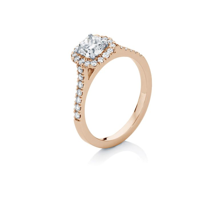 A FIRM FAVOURITE - The 'Rosetta' by Larsen Jewellery. A beautiful micro-claw halo engagement ring, set with small Brilliant cut diamonds, and a centre Cushion cut diamond. Available in Yellow, White & Rose Gold, or Platinum, and with your choice of diamond or coloured gemstones.