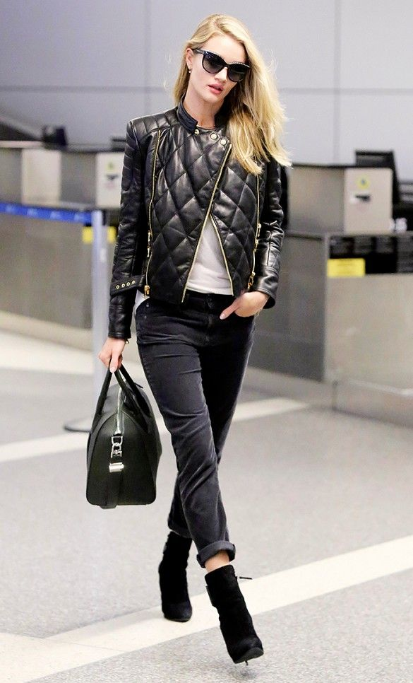 Rosie Huntington-Whiteley in black cuffed skinnies, ankle boots, and quilted leather jacket.