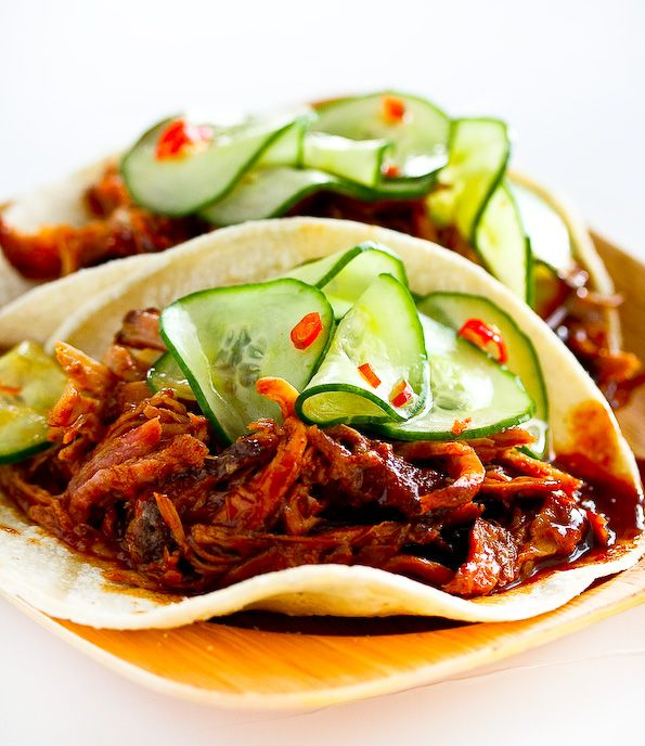 Korean Style Tacos   serves 4  1 pound cooked pulled pork, cooked shredded chicken  12 corn or flour tortillas  1/4 cup Quick Cucumber Pickle (1 large cucumber, sliced very thinly, 2 tablespoons rice vinegar,1/2 teaspoon sugar, 1/2 teaspoon finely minced fresh chili pepper, & generous pinch of salt) or prepared kimchi