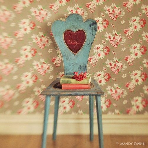 wooden chair with red velvet heart.