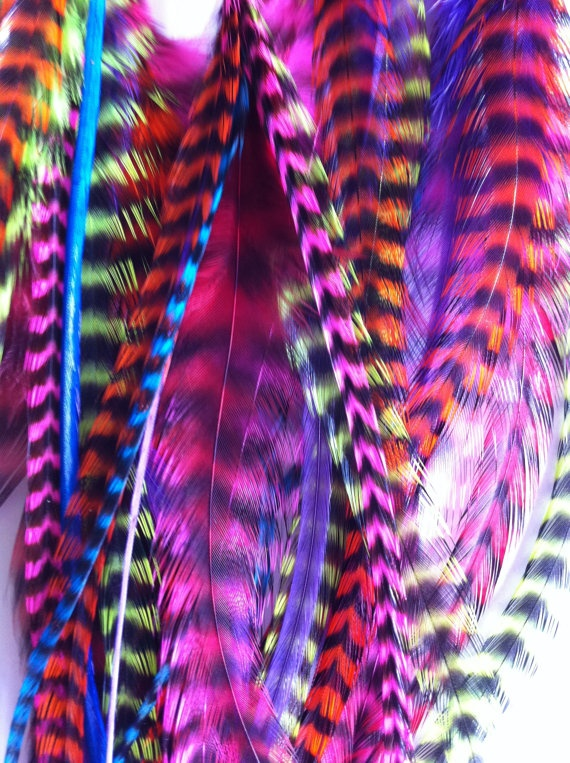 Colourful feathers all around. Visit www.colourfast.com for all your vivid and beautiful printing needs.