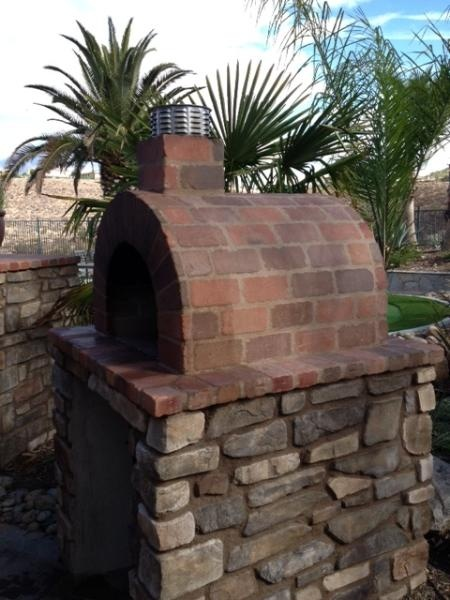 A beautiful Wood Fired Brick Pizza Oven & Fireplace combination in Sunny CA! The oven was built using the Mattone Barile foam oven form by BrickWoodOvens.com