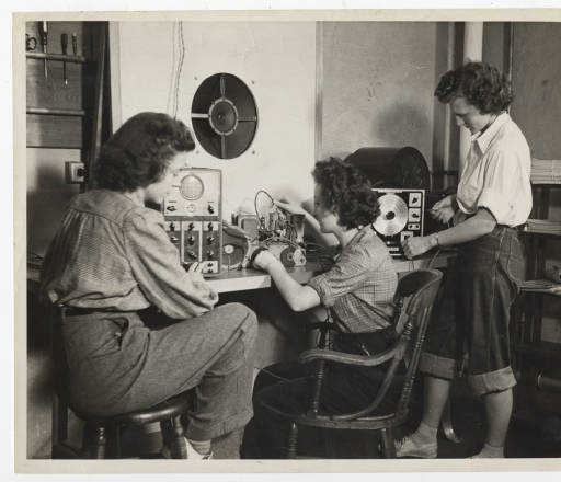 Barbara Brigham 44 (left) and Dorothy Bergamini 44 (right) working with another student in the Physics Department radio laboratory :: Archives & Special Collections Digital Images :: 1943
