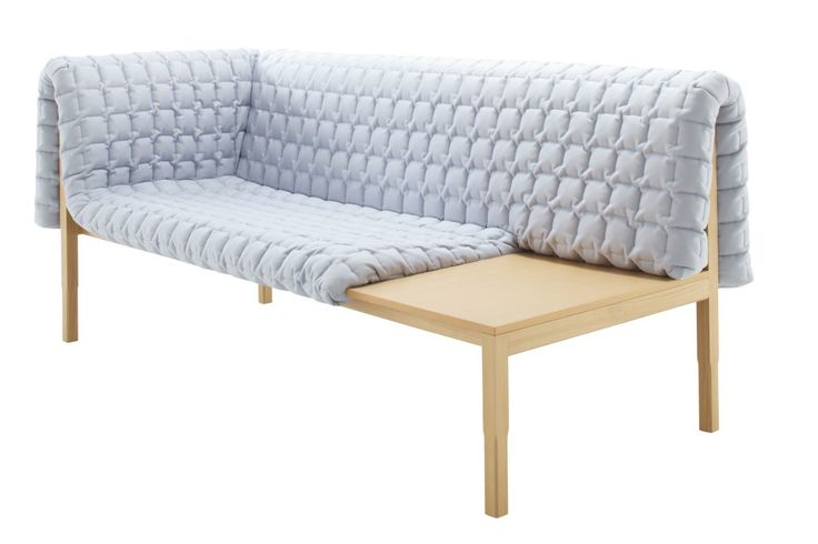 This sofa contains a secret.I need softness tosatisfy my need for order and aesthetic expression. The stark wood base of this sofa is pure minimalism. But the upholstered, quilted blanket wrapping the minimalist frame is traditional anddeliberately loose fitting.