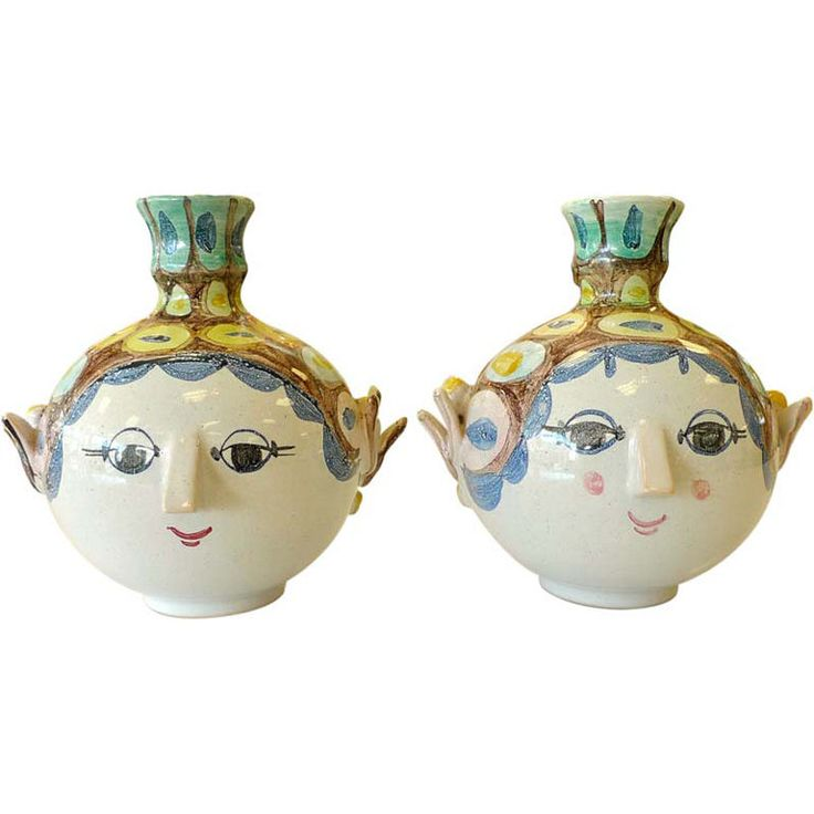Pair of Bjorn Wiinblad Candle Holders  Denmark  1979  Pair of hand painted ceramic candle holders in form of a head with face, signed and dated, by Bjorn Wiinblad, Denmark