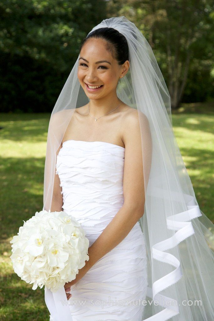 This shape and bouquet is a modern day classic. The white hydrangea sphere. Sophisticated and simple. This suited both the bride and the dress very well.