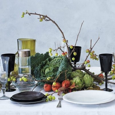 Bon Appetit.  Love the black and white color palette all dolled up greenery.