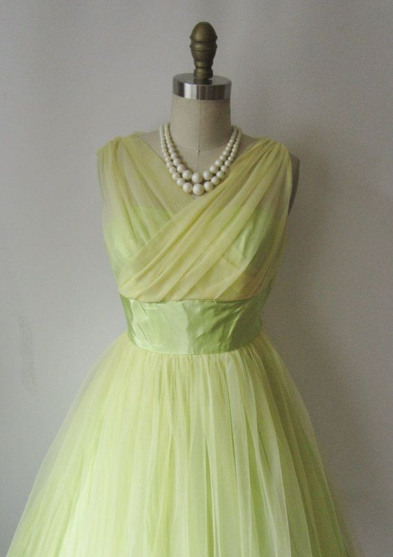 Oh, I love vintage dresses...this color is soo pretty.